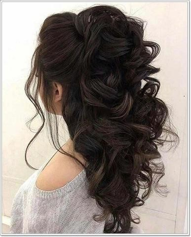 half up half down curly hairstyle